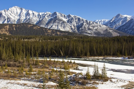 Bow River flowing through the Rocky Mountains in Banff, Canada photo