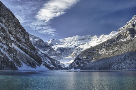 settles: Early winter snow settles on Lake Louise, Alberta in the Canadian Rockies