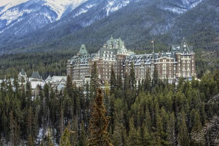 Luxurious Banff Springs Hotel in the Canadian Rockies, Alberta. It looks like a castle among the green trees. photo