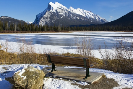 Mount Rundle reflected in the icy waters of Vermillion Lakes near Banff, Alberta, Canada photo