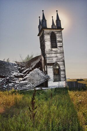 Nature has taken its toll on this old white church on the Canadian prairies.