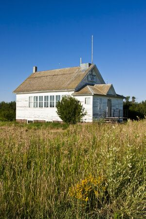 schoolhouse: An old-fashioned vintage white one roomed schoolhouse Editorial