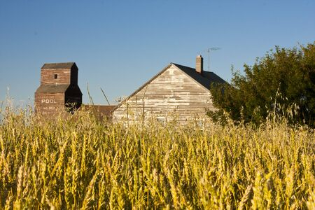 Vintage old-fashioned buildings abandoned in an old ghost town photo