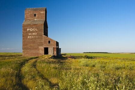 Abandoned grain elevator in the ghost town of Bents on the Canadian prairies photo