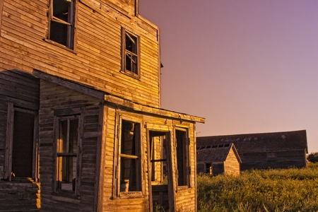 An old-fashioned vintage general store in a ghost town at sunset photo
