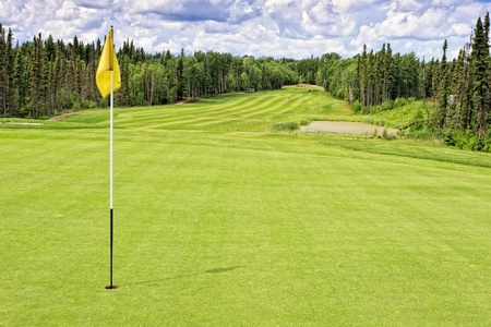 Golf course in the thick forest at Elk Ridge Resort in Saskatchewan, Canada photo