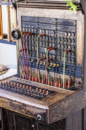 Vintage telephone operators board with wires and plugs photo