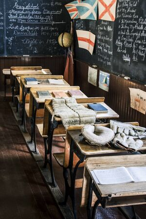 Row of desks in an old classroom