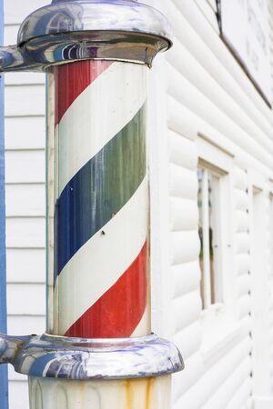 Red and blue striped classic barber shop pole photo