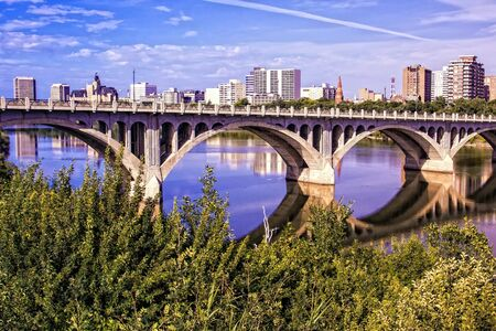 Saskatoon cityscape with the University Bridge crossing the South Saskatchewan River. photo