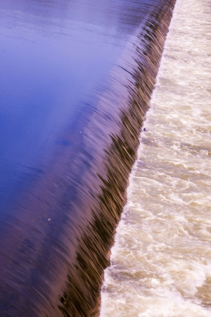 dike: A large spanned weir crosses the river to generate power. Stock Photo