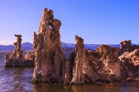 Tufa tower rock formations in Mono Lake are calcium-carbonate spires and knobs formed by interaction of freshwater springs and alkaline lake water.