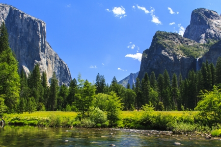 Yosemite Valley with the landmarks of El Capitan, Cathedral Rocks, and Bridalveil Falls at the Merced River