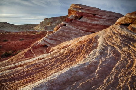 derives: Valley of Fire State Park in Nevada, USA derives its name from red sandstone formations including unique Fire Wave.