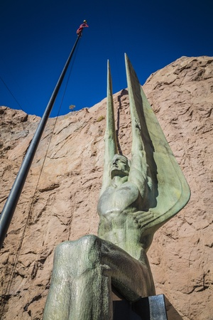 Famous statue Winged Figures of the Republic greats tourists at the Hoover Dam, Nevada.