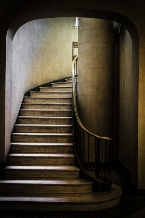 leading light: Old staircase leading up towards the light Stock Photo