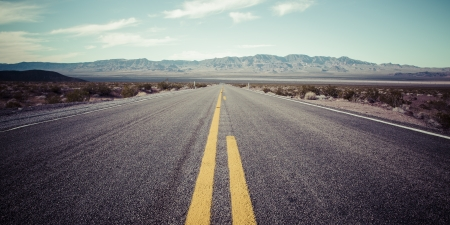 desert highway: Long desert highway to the mountains under the hot sun