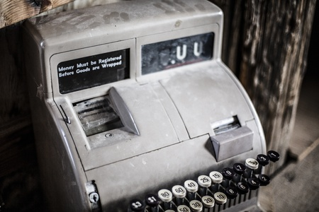 An old rusty antique cash register Banco de Imagens