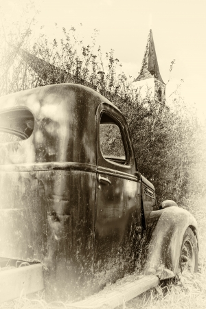 rusting: The old truck rusting away in the bush behind the church