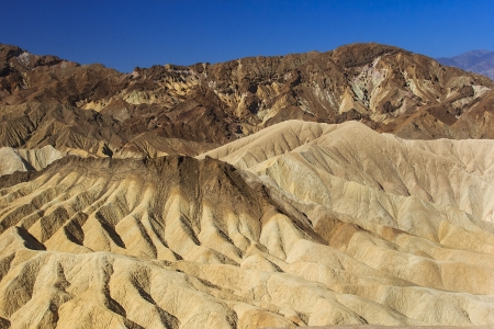 Zabriskie Point is in Death Valley National Park in the United States noted for its erosional landscape photo