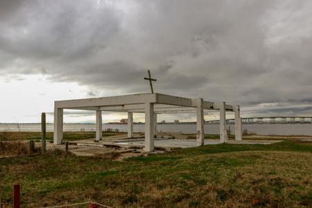 Abandoned building frame with cross Banco de Imagens