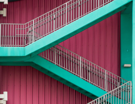 Pink wall with green stairs