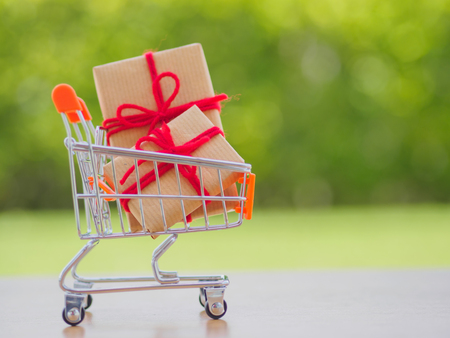 Celebration concept. Many New Year and Christmas presents or gifts represented in shopping cart Stock Photo