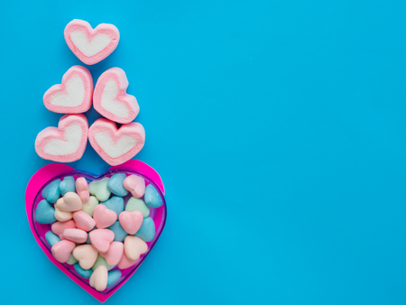 post: Marshmallow in a heart frame on Valentines Day love concept on blue sky background