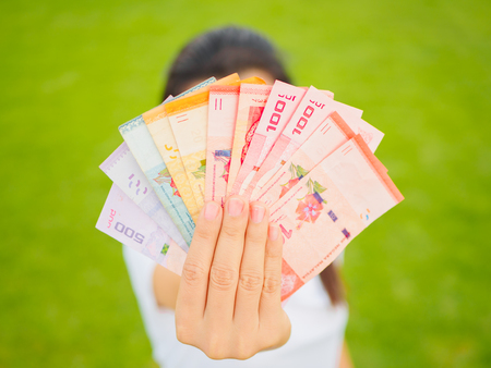 A lot of money in woman hand. Business and economy concept.