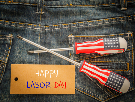 Labor day background concept - Jeans, many handy tools with labor day text on Jeans background top view