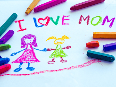 mothering: Kid drawing of mother holding her daughter for happy mothers day theme
