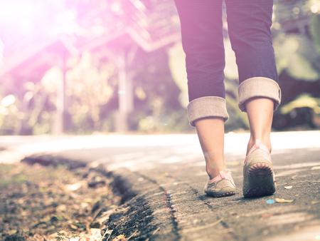 woman walking towards on the road side.
