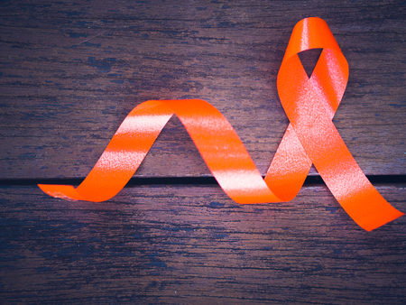 World AIDS day concept. red ribbon on wooden background Stock Photo