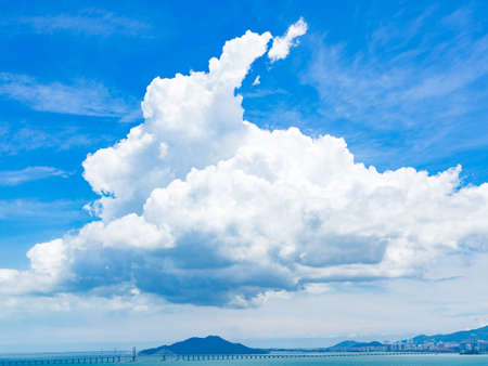 Blue sky with white clouds over Penang brigde