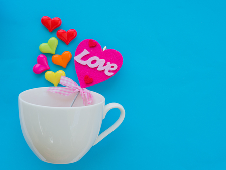 heart shaped: White cup with colorful of heart on Valentines Day love concept on blue sky background