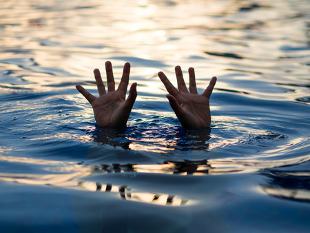 Drowning victims, Hand of drowning man needing help. Failure and rescue concept.