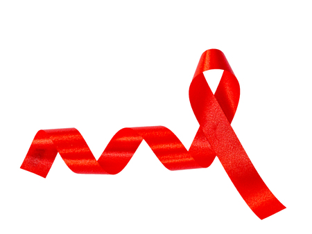 aids awareness ribbon: World AIDS day concept. red ribbon on white paper Stock Photo