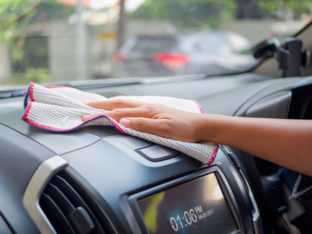 rag wheel: Hand cleaning interior car with microfiber cloth Stock Photo