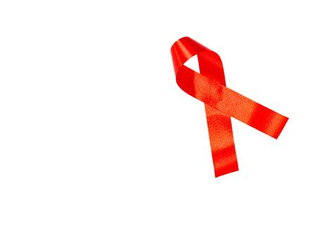 World AIDS day concept. red ribbon on white paper Stock Photo