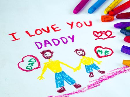 Kid drawing of father holding his child for happy fathers day theme with I LOVE YOU DADDY message. Stock Photo