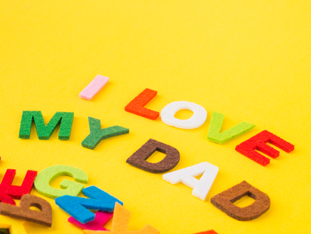 Fathers day concept. I LOVE MY DAD alphabet on yellow background.
