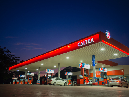 than: Kedah, Malaysia - June 9, 2017: Caltex gas station blue sky background during sunset. Caltex is a petroleum brand name of Chevron Corporation used in more than 60 countries. Editorial