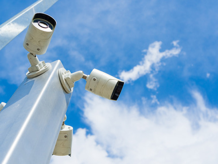 Closed-circuit television or CCTV Security camera on blue sky background Stock Photo