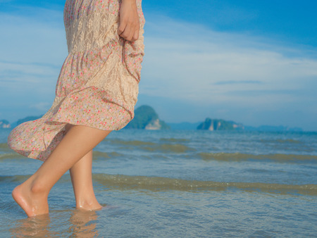 footprints in sand: Beach travel - woman walking on sand beach. Closeup detail of female feet .Step up concept. Stock Photo