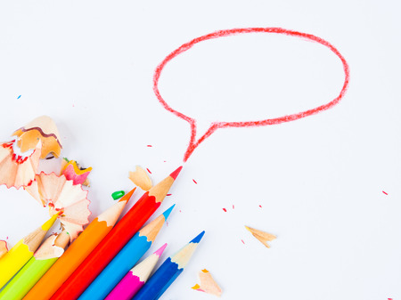 Colorful pencils with colorful pencil shavings on white background. Back to school concept.