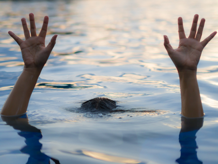 Drowning victims, Hand of drowning woman needing help, selective focus.  Failure and rescue concept. Stock Photo