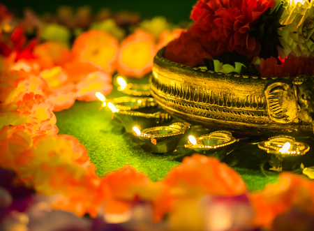 colourful lightings: Traditional clay diya lamps lit with flowers for Diwali festival celebration. Stock Photo