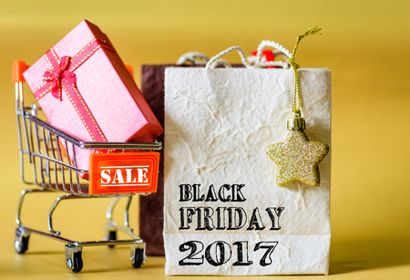 Soft focus mini shopping cart and shopping bags with label tags ,Black Friday sale concept. Stock Photo