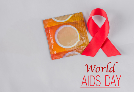 Soft focus red AIDS awareness ribbon on white background. World Aids day concept.
