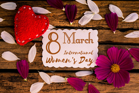 8 March Happy International Womens Day message on wooden background with handmade red heart and white and purple flowers. Womens Day concept. Stock Photo